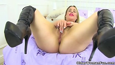 English milf Tammy is up to no good in her slutty long boots