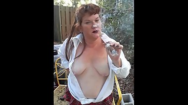 Topless BBW Schoolgirl Smoking Cigar