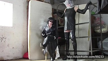 Mistress in two-row coat and her leather sissy with plastic bag
