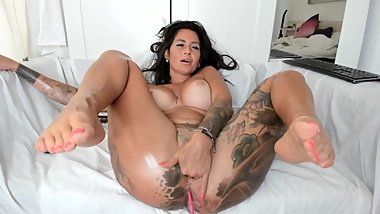 Tatooed Milf fingers her creamy pussy