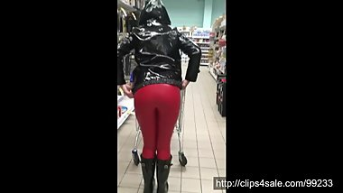 Shopping in red leather leggings, PVC raincoat and Hunter wellies