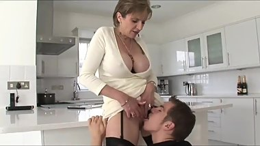 Sexy mature mother with big tits seduces and fucks her stepson