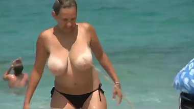 My busty mom with no bra on the public beach