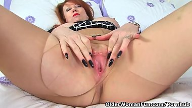 British milf Red has dildo fun in tan tights