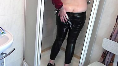 In the shower: red jacket and tight leather leggings