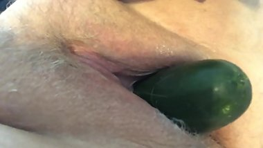 Close up MILF fucks herself with a cucumber