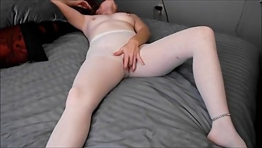 MILF fingers herself in white pantyhose