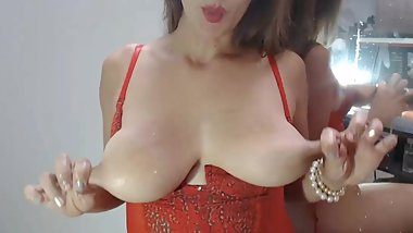 Lactating MILF pulls nipples and milks