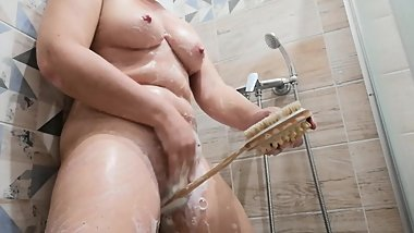 Masturbation in the shower with bath brush.