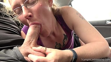 Redhead MILF Ivy gives a long hands free blowjob to hubby in a parking lot