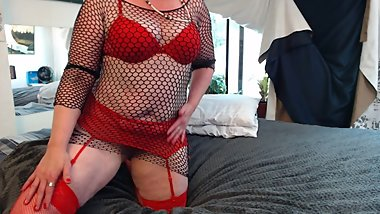 redhead in red garter and stockings plus black fishnet tease