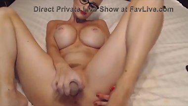 Busty MILF plays with cunt and anal hole