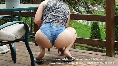 Spying on amateur Milf doing outdoor chores