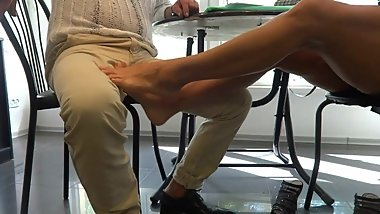 milf footjob under table tease very very sexy