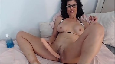 Cougarlicious brunette in sexy glasses throat fucking
